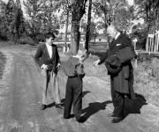 Lord Beaverbrook talking to two young boys.