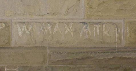 Max Aiken's name carved into the brick of the Beaverbrook House.